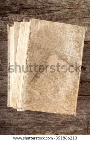 Book with old canvas cover on the wooden background - stock photo