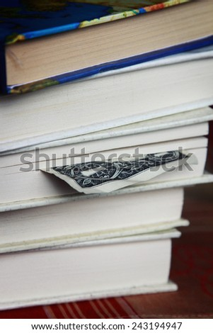 Book with one dollar bookmark, One dollar banknote used as book marker - stock photo