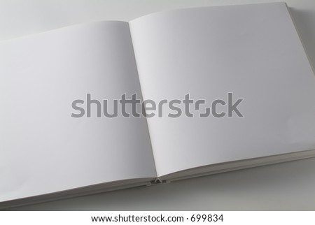Book with white pages on white background. - stock photo