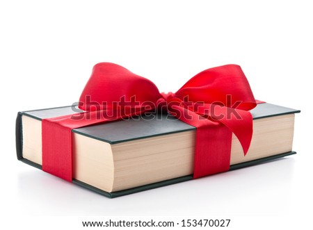 Book wrapped with a ribbon - stock photo