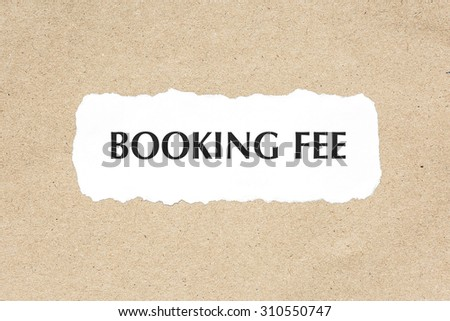 Booking fee word on white ripped paper on brown document texture - stock photo