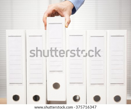 bookkeeper took a binder from the archive, bookkeeping and accounting concept - stock photo