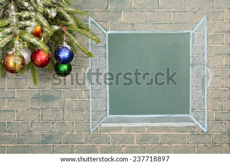 Books and Christmas decorations before blackboard with blank space for your text - stock photo