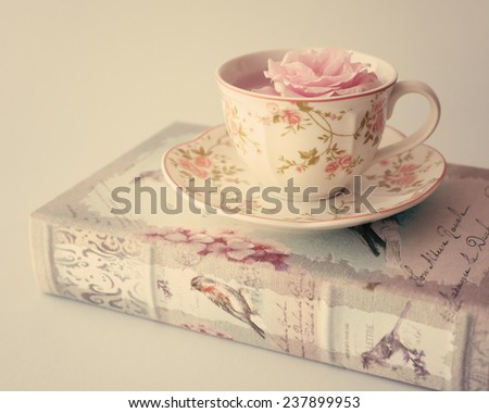 Books and cup of tea - stock photo