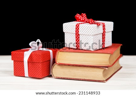Books and gift boxes - stock photo