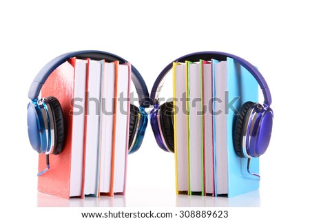 Books and headphones as audio books concept isolated on white - stock photo