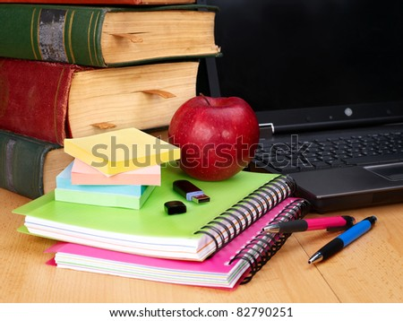 Books and laptop. School supplies.. Back to school. - stock photo