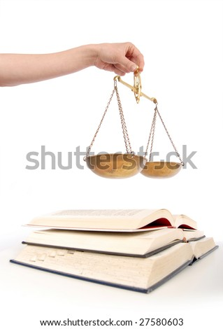 Books and legal balancing scales of equality - stock photo
