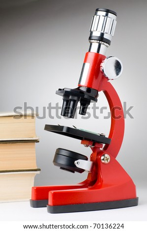 books and microscope, scientific or educational concept - stock photo