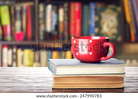 Books and red cup - stock photo