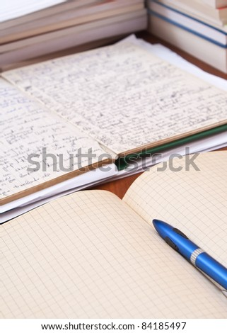 books and volumes on the table,back to school - stock photo