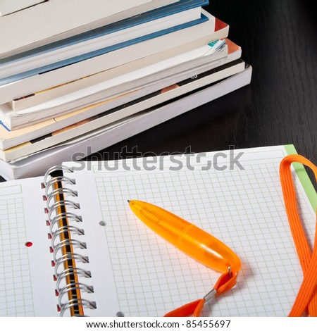 books and volumes on the table,close up photo - stock photo