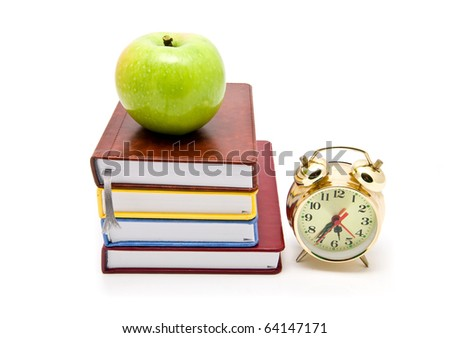 books, clock and apple on a white background - stock photo