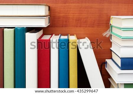 Books. Close up of bookshelf. Colorful books. Wood grain background.  - stock photo