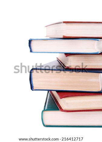 Books in a mess isolated on white - stock photo