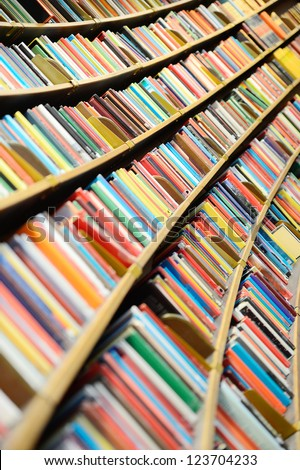 Books in round library shelf - stock photo