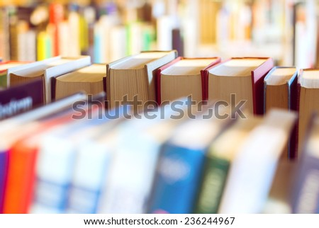 Books on a bookshelf in a library - stock photo