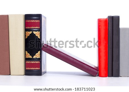 Books on a shelf with blank spines for copyspace - stock photo
