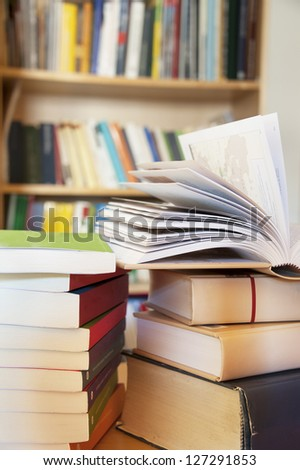 books on a table in library - stock photo