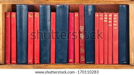 books on the shelf - red and blue - wallpaper  - stock photo