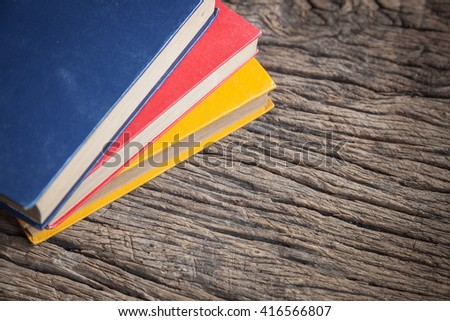 Books on wood table - stock photo