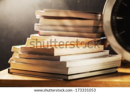 books stack on desk - stock photo