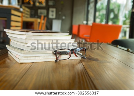 Books with glasses on table, vintage picture style - stock photo