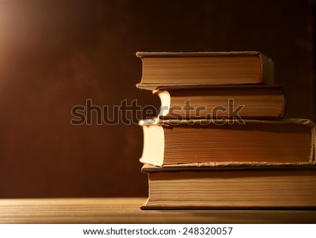 Books with light over dark background - stock photo