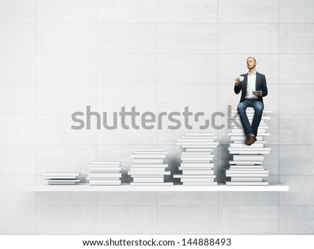 bookshelf and man with cup of coffee - stock photo