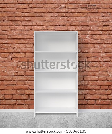 bookshelf and red brick wall - stock photo