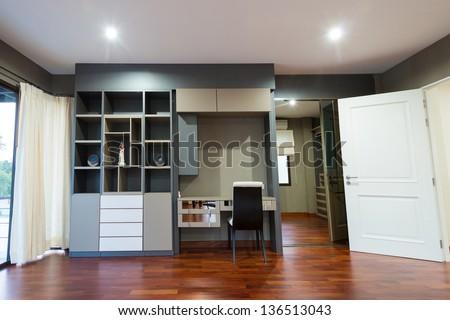 Bookshelf and the desk in modern room - stock photo