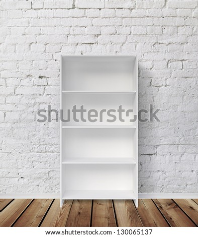 bookshelf and white brick wall - stock photo