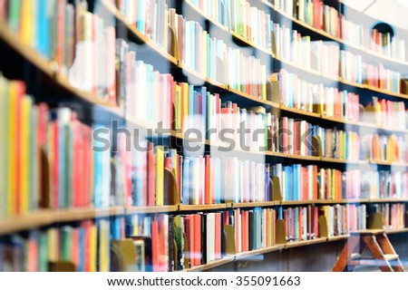 Bookshelf in public library, street reflection - stock photo