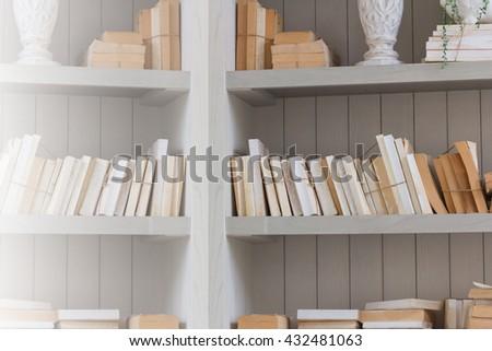 Bookshelf is white book with wooden white shelf, bookshelf background,, bookshelf concept, bookshelf backdrop, bookshelf copy space, bookshelf vintage, bookshelf classic. - stock photo
