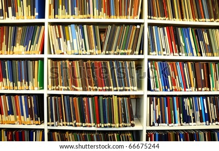 bookshelf or book shelf in a university library - stock photo