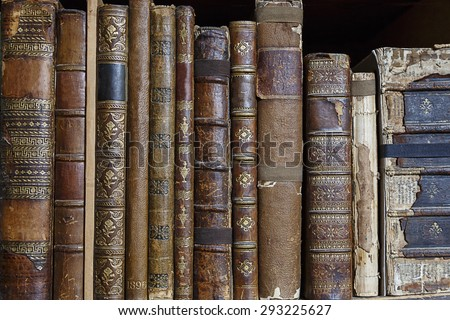 Bookshelf with row of antique books - stock photo