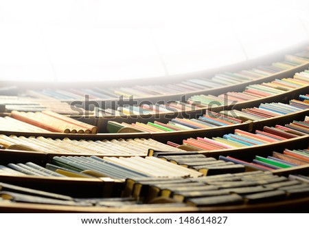 Bookshelve seen from under - stock photo