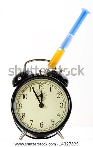 Boosting time with syringe - stock photo