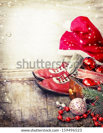 Boots and a hat of Santa Claus with Christmas decorations/Closeup of Christmas ball with pine branch and gifts on abstract background. - stock photo