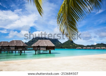 Bora Bora, Sea, Beach, Mountains and Bungalows (House) - stock photo
