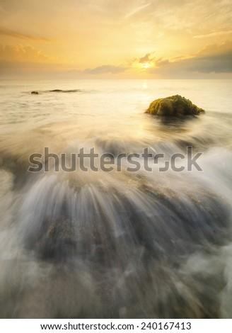Bora Bora Waves Flow Hit the Rock During Sunrise - stock photo