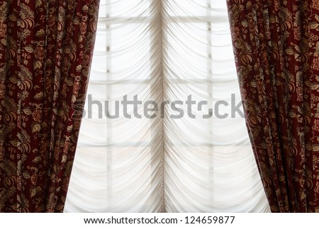 Bordeaux blind on window - stock photo
