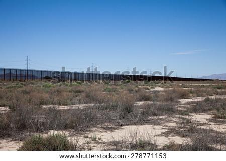 Border Fence - stock photo