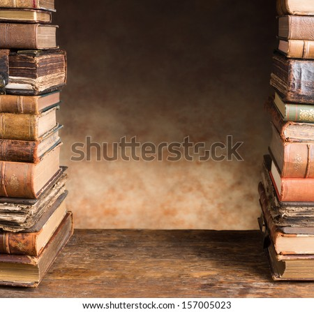 Border frame image of two stacks of antique books - stock photo
