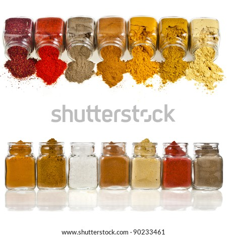 border frame of powder colorful spices in glass bottle isolated on white background - stock photo