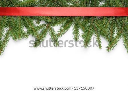 border from fir twigs and ribbon with shadow, on white background - stock photo