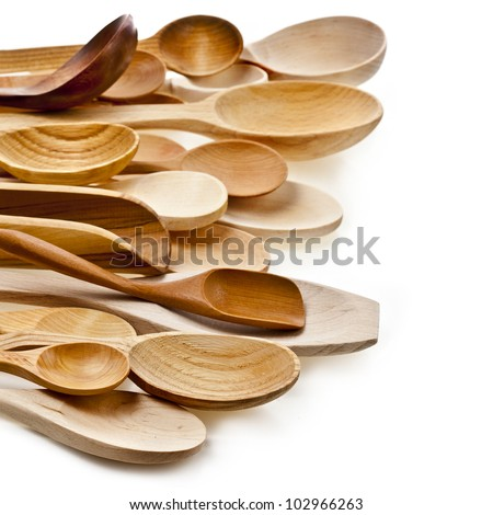 border of different kitchen wooden utensils cutlery close up on a white background - stock photo