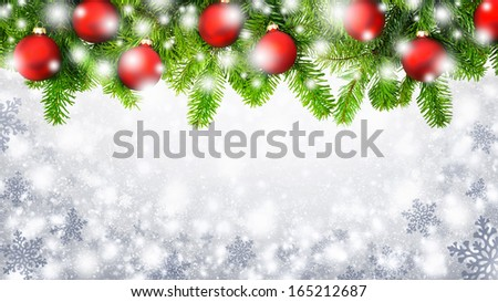 Border of fir twigs decorated with red Christmas baubles on silver background with large snowflakes - stock photo