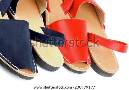 Border of Red and Blue Leather Summer Sandals isolated on white background - stock photo