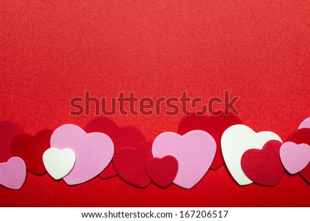Border of romantic red pink and white hearts for Valentines day - stock photo